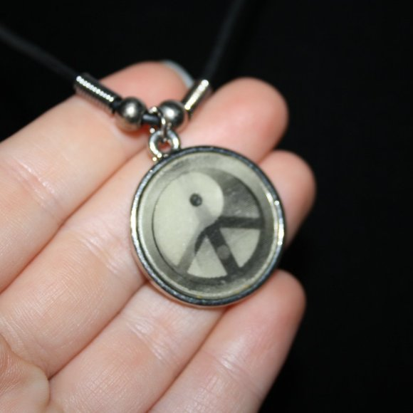 Black cord necklace with peace ying yang pendant